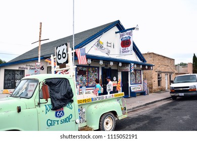Seligman, AZ, USA - July 24, 2017: Seligman is full of Route 66 transportation reminders. Pictured here Angel and Vilmas Route 66 Gift Shop a classic route 66