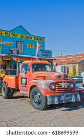 "Seligman, AZ, USA - September 4, 2016:  Seligman is full of Route 66 transportation reminders.  Pictured here is Seligman Sundries with the Cars character ""Mater"" the tow truck parked out front."