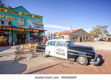 SELIGMAN, USA - SEPTEMBER 10, 2016: Old police car in front of historic Sundries Building. The town was on the original U.S. Route 66 from 1926 through 1978, when Interstate 40 bypassed it on south.