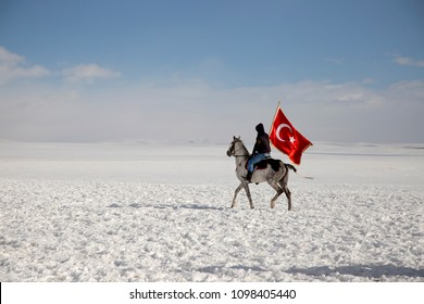 Selim Village in Kars A man riding horse with flag. A special old turkish horseman competition with javelin.