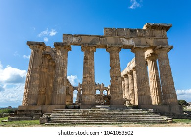 Selinunte, Trapani, Sicily: front view of the ancient greek temple at the archeological site of Selinunte, Trapani, during a sunny day, with blue sky and clouds.