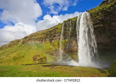 Seljalandsfoss with rainbow --Beautiful Waterfall in Iceland