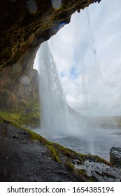 Seljalandsfoss is a waterfall in Iceland. The waterfall drops 60 m and is part of the Seljalands River that has its origin in the volcano glacier Eyjafjallajökull. Visitors can walk behind the falls.