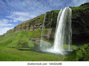 Seljalandsfoss waterfall and rainbow in Iceland