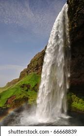 Seljalandsfoss waterfall with rainbow, south Iceland