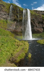 Seljalandsfoss waterfall with a river in southern Iceland
