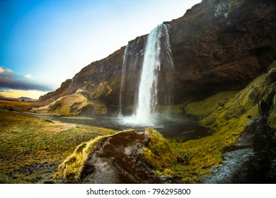 Seljalandsfoss, a waterfall with a small cave behind it in the south region in Iceland, it is part of the Seljalands River that has its origin in the volcano glacier Eyjafjallajokull