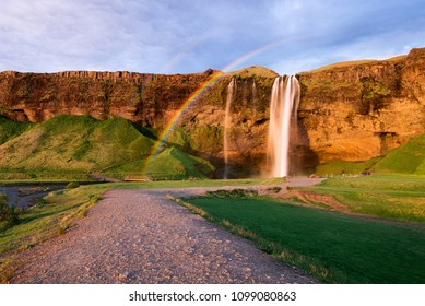 Seljalandsfoss waterfall. Summer landscape with cascade and a river. Amazing light of the evening sun. Famous tourist attraction of Iceland