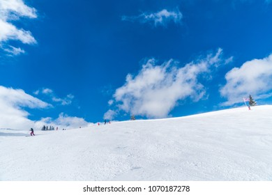 Sell Am See, Austria, April 1 2018, people sking on a quiet slope with a blue sky at the Ski resort