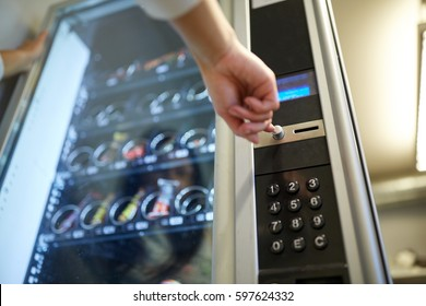 sell, technology and consumption concept - hand pushing button on vending machine operation panel - Shutterstock ID 597624332