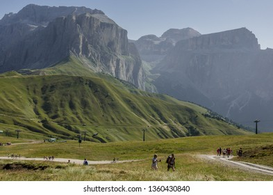 Sella mountain group, Dolomites, South Tyrol, Italy - August 22, 2011: Hikers ascending from Sella mountain pass on their hike to Sassopiatto refuge