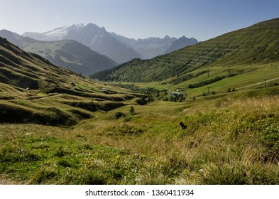 Sella mountain group and Marmolada mountain in the far background, as seen from the trail to Sassopiatto refuge from Passo Sella refuge, Dolomites, South Tyrol, Italy