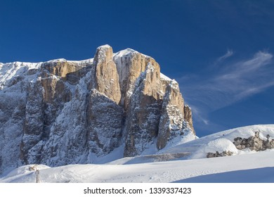 Sella Towers in Winter covered in Deep Snow. Passo Sella during a Sunny Winter Day just above Selva Val Gardena