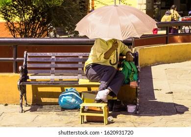 seller covering the sun in San Cristobal de las Casas, Mexico