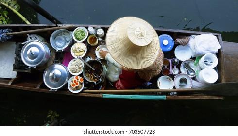 Seller on boat , floating market ,Thailand