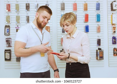The seller shows the buyer the goods