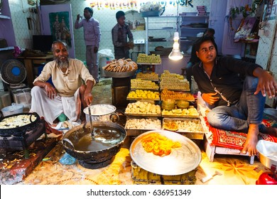 Sellers mans are trading sweets in the store India . India, Govardhan, November 2016