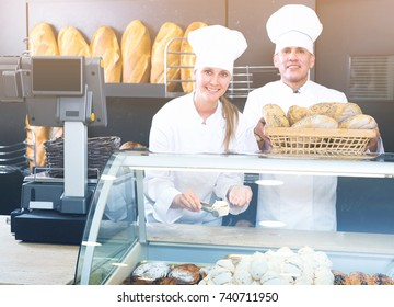 Sellers are offering tasty and fresh bread products in bakery.