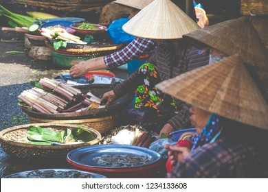 Sellers on the local market in Vietnam. Traditional food market in Hue, Vientam.