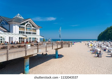 SELLIN, GERMANY - JUNE 23, 2016: Beach with detail of the pier in Sellin on the island of Rügen at the Baltic Sea