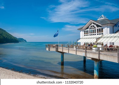 SELLIN, GERMANY - JUNE 23, 2016: Coast with detail of the pier in Sellin on the island of Rügen at the Baltic Sea