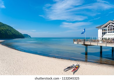 SELLIN, GERMANY - JUNE 23, 2016: Coast and beach with detail of the pier in Sellin on the island of Rügen at the Baltic Sea