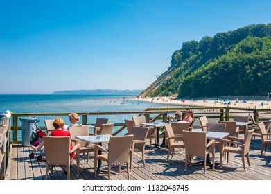 SELLIN, GERMANY - JUNE 23, 2016: Detail of the pier and beach in Sellin on the island of Rügen at the Baltic Sea