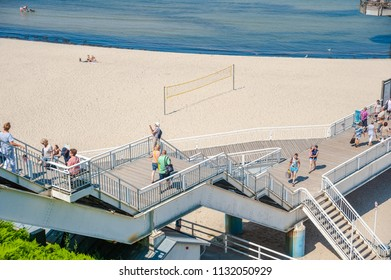 SELLIN, GERMANY - JUNE 23, 2016: Tourists on the stairs leading over the steep coast to the pier in Sellin on the island of Rügen at the Baltic Sea