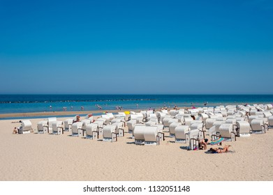 SELLIN, GERMANY - JUNE 23, 2016: Beach and canopied wicker beach chairs in Sellin on the island of Rügen at the Baltic Sea