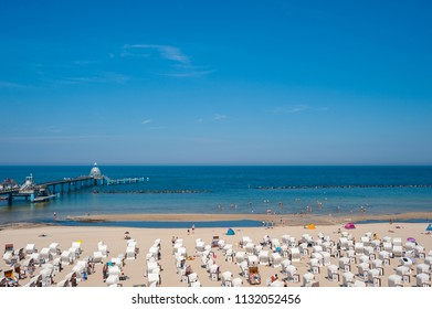 SELLIN, GERMANY - JUNE 23, 2016: Beach with pier in Sellin on the island of Rügen at the Baltic Sea