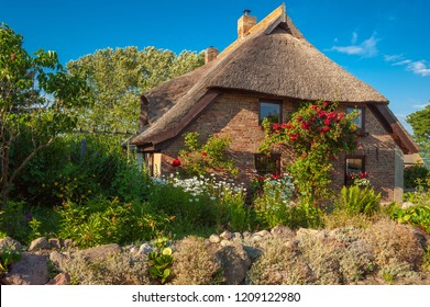 SELLIN, GERMANY - JUNE 23, 2016: Detached house with a thatched roof  in Altensien. Altensien is a part of town of Sellin on the island of Ruegen
