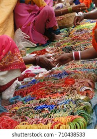 Selling bangles and other jewelry at the weekly market in Kunduli, Orissa in India