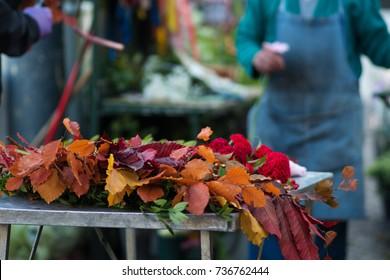 Selling flowers on the street, men do fall bouquet