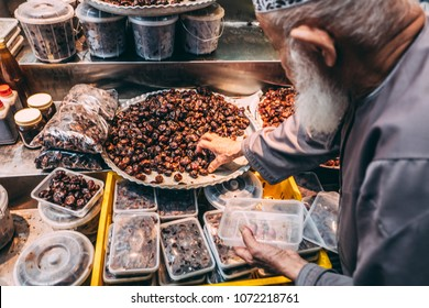 Selling fresh date fruits at the local market in Muscat, Oman