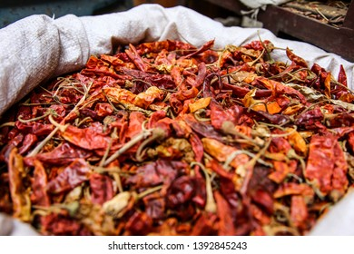 Selling fresh dried chillies on a street market in blue bags, Basar in Egypt