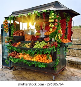 Selling fresh fruits and vegetables on the streets of Acre in Israel at morning
