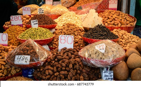 Selling fried fruits at street market in Old Delhi, India. Delhi is said to be one of the oldest existing cities in the world, along with Jerusalem and Varanasi.