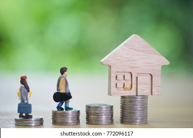 Selling home,Little house toy and money.