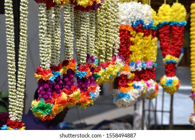Selling Indian Flower Garlands at the Market