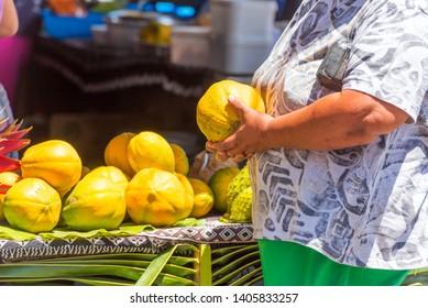 Selling papaya in the local market, Rarotonga, Aitutaki, Cook Islands. With selective focus