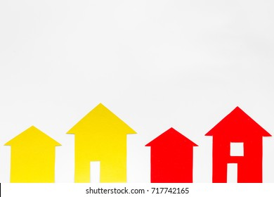 selling property online with paper house on office desk white background top view mockup