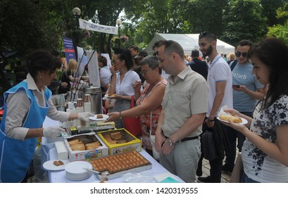 Selling traditional oriental sweets during the Kiyv East Fest festival dedicated to the Islamic holiday of Ramazan Bayram in Taras Shevchenko Park, in Kiev, June 5, 2019