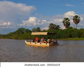 Selous Game Reserve, Tanzania - 22 November 2015: Boat safari at sunset in where Lions, hippos, elephants, leopards, buffalo can all be seen.