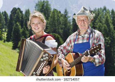 SELVA DI VAL GARDENA, ITALY - JULY 2012: South Tyrol musicians are playing traditional Folklore songs, on July 19, 2012, at a mountain hut close to Selva di Val Gardena,in Trentino-Alto Adige region.