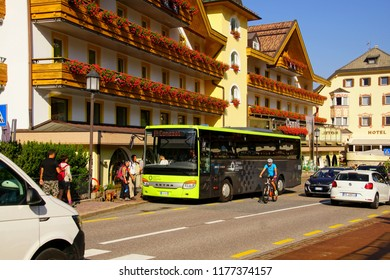 SELVA, ITALY - AUG 5, 2018 - Bus arrives in the alpine village of Selva Wolkenstein in the Dolomites Alps, Italy