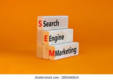 SEM search engine marketing symbol. Wooden blocks with words 'SEM search engine marketing' on beautiful orange background, copy space. Business, SEM search engine marketing concept.