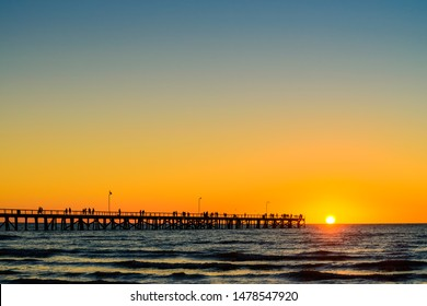 Semaphore Beach  jetty with people at sunset, South Australia