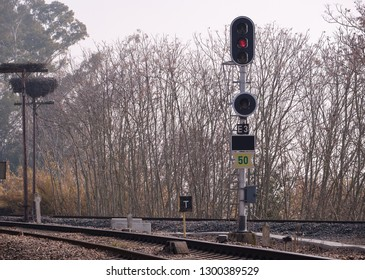 Semaphore view of entrance to railway station with storks nests in the background