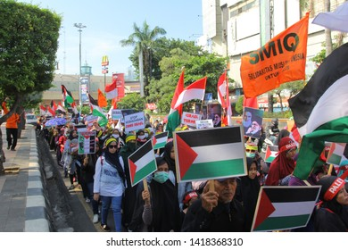 Semarang, Central Java, Indonesia. Community Commemorates 2019 International Al-Quds Day on Friday (05/31/19) and walks in the urban center