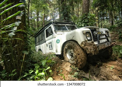 Semarang, Central Java, Indonesia. January 17 - 2016. Old classic 4x4 landrover series offroading jungle forest at Central Java, Indonesia.
